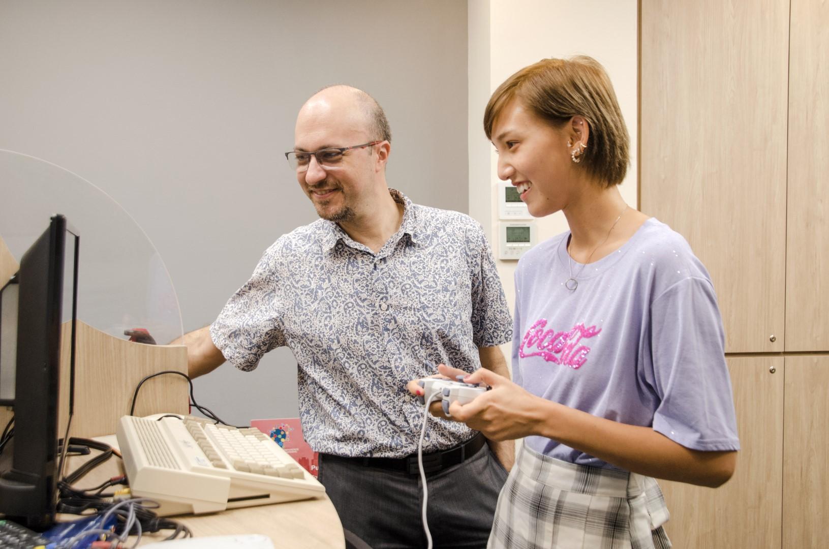 Associate Professor Roberto Dillon and student
